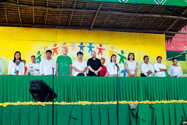 The visitors were given seats of honor on the grandstand at the opening of the Organic and Cultural Festival.